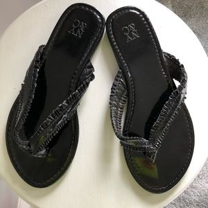 Shiny black flip flops